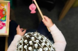 a child in an eeg helm