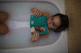 a girl reading in a bath