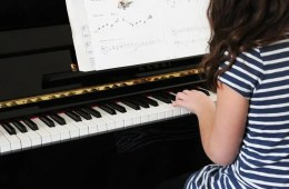 a girl playing piano