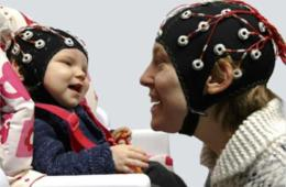 baby and parent in eeg caps