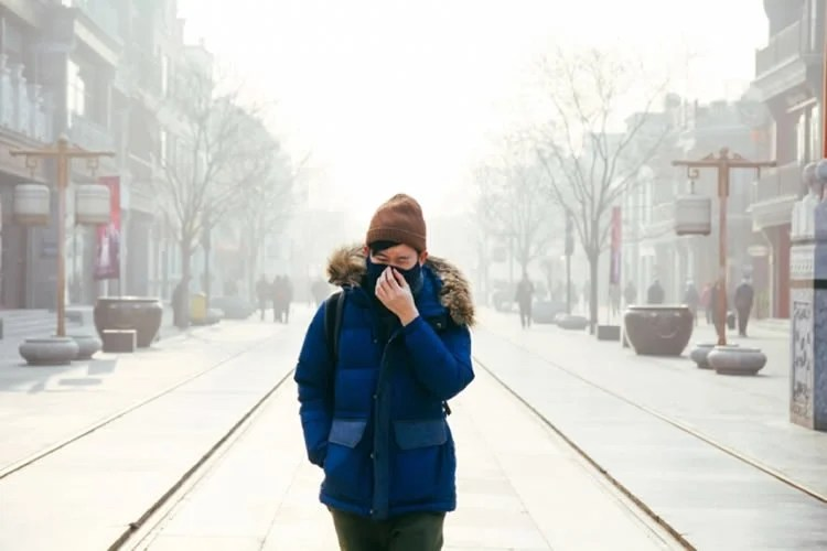 a person walking in smog