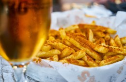 This image shows beer and fries