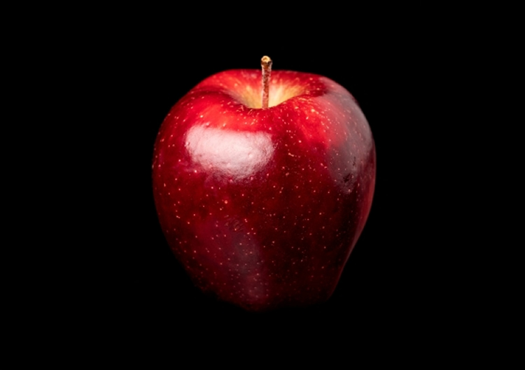 This is a shiny red apple