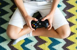 This shows a child with a gaming controller