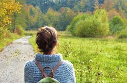 This shows a woman walking in nature