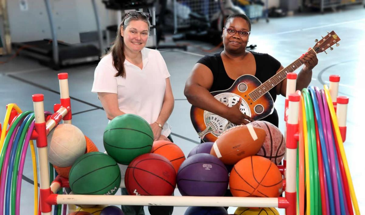 This shows the researchers with a guitar and basketballs