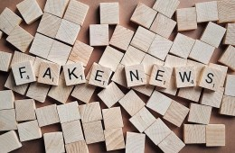 Fake News is spelled out in scrabble pieces