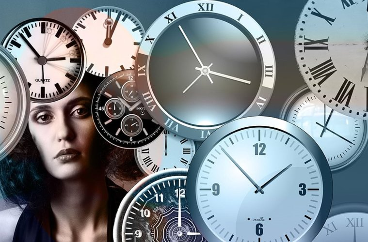 This shows a woman surrounded by clocks
