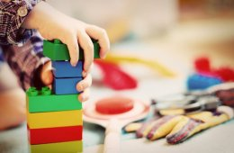 This shows a child building with blocks