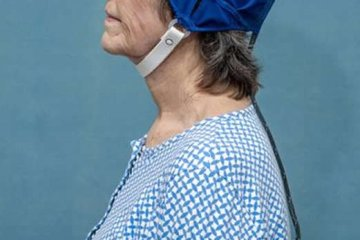 This shows a woman wearing the TEMT head device
