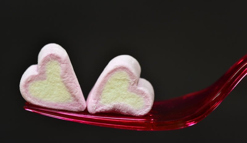 This shows two heart shaped marshmallows