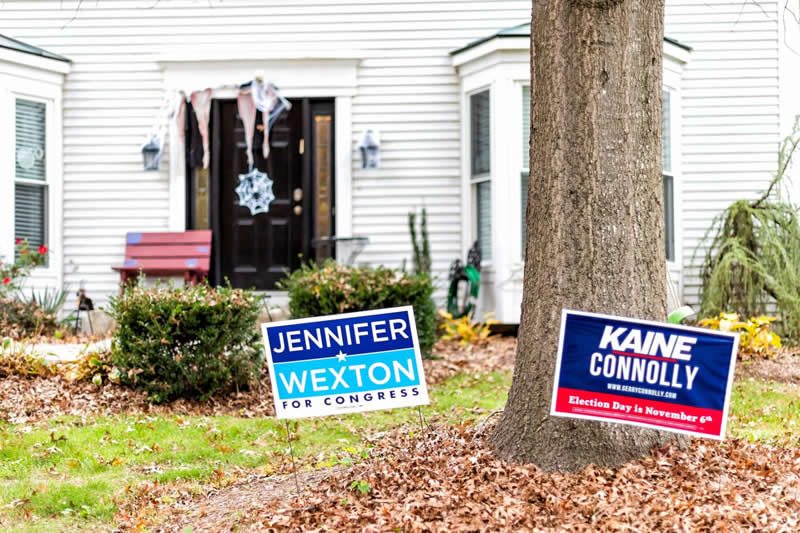 This shows campaign signs in a person's yard