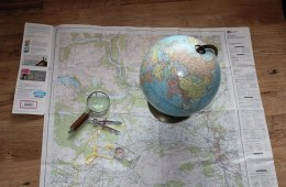 This shows a map and a globe