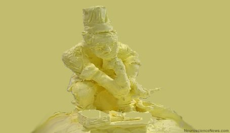 A sculpture of a man made from what looks like butter is shown in a thinking position.
