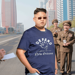 Decked out in a Defend NOLA, North Korean Supreme Leader Kim Jong Un talks with a reporter about his nation's move to help the impoverished city of New Orleans.