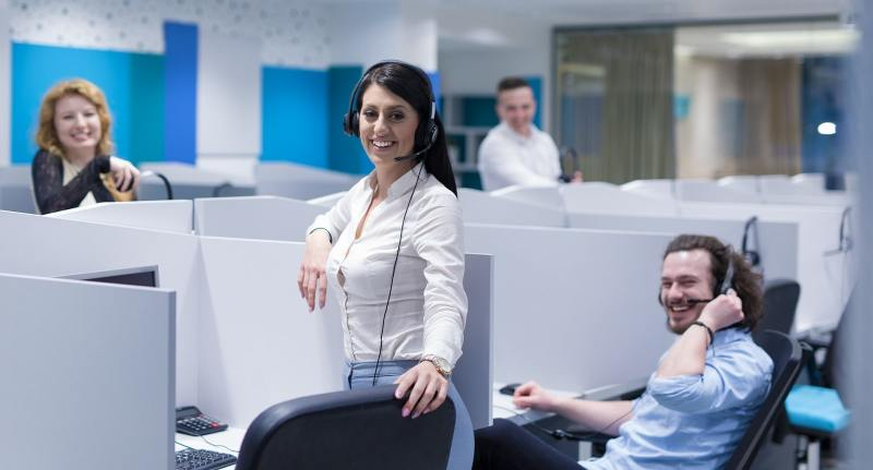 A happy call center team working in the office