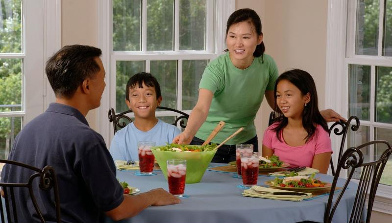 Happy family taking meal together