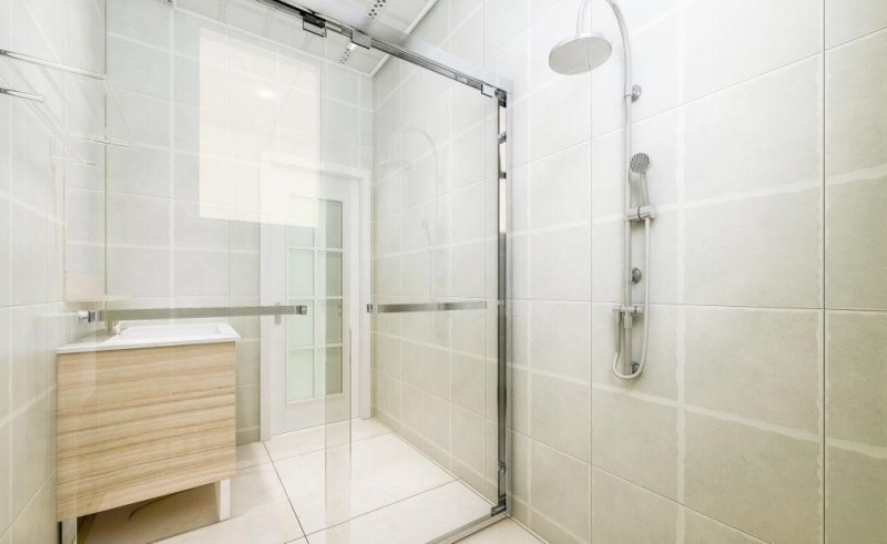 Glass shower door allows more light