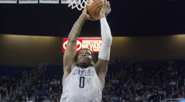 Cam Oliver takes flight against the Boise State Broncos in Lawlor Events Center on Feb. 22. Nevada sits atop the MWC, tied with CSU with an overall record of 23-6 and conference recrord of 12-4.