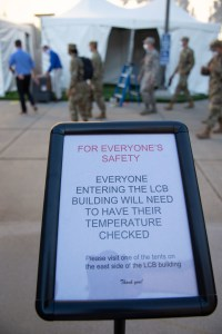 A sign outside the Nevada Legislature in Carson City announcing temperature checks before the first day of the 31st Special Session of the Nevada Legislature in Carson City, Nev., on Wednesday, July 8, 2020. (David Calvert/The Nevada Independent)