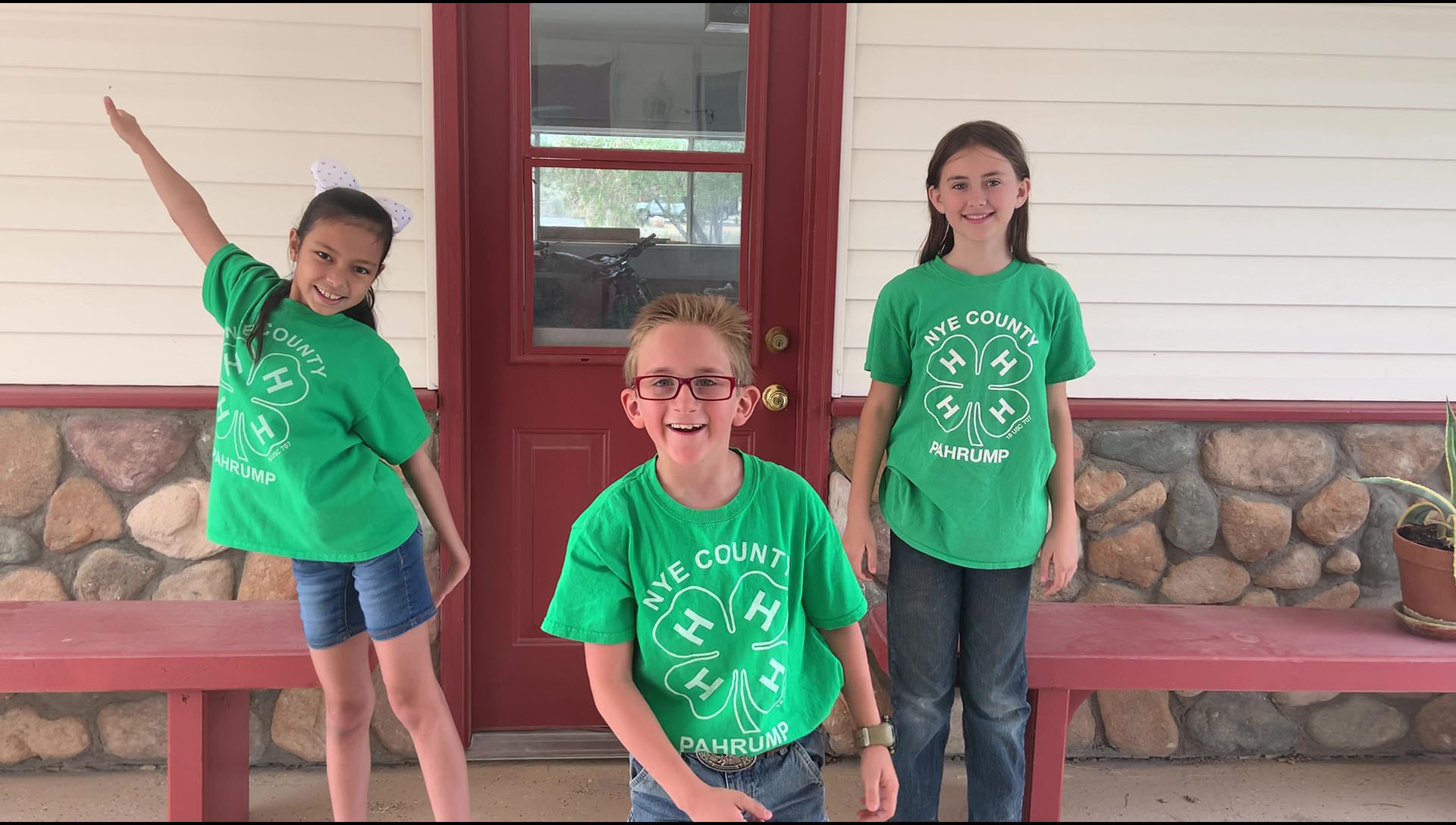 "4-H youth have been encouraged to make videos or take photos at home to share with others, like this one from the ""Dog Den"" of 4-H in Pahrump, featuring Anoushka (left back), Alaina (right back) and Increase (front center)."