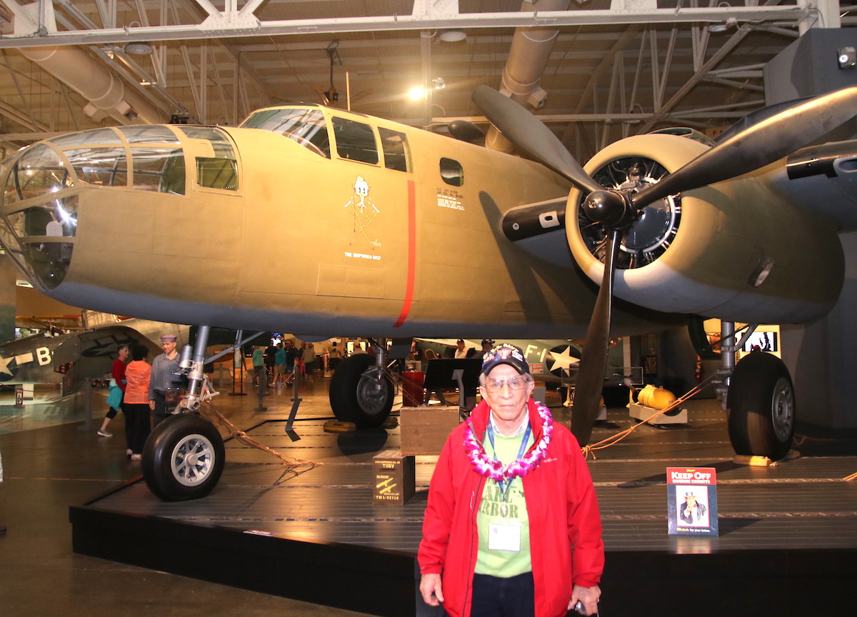 Standing in front of a B-25 bomber at the Pearl Harbor Aviation Museum is Gilbert Sanchez