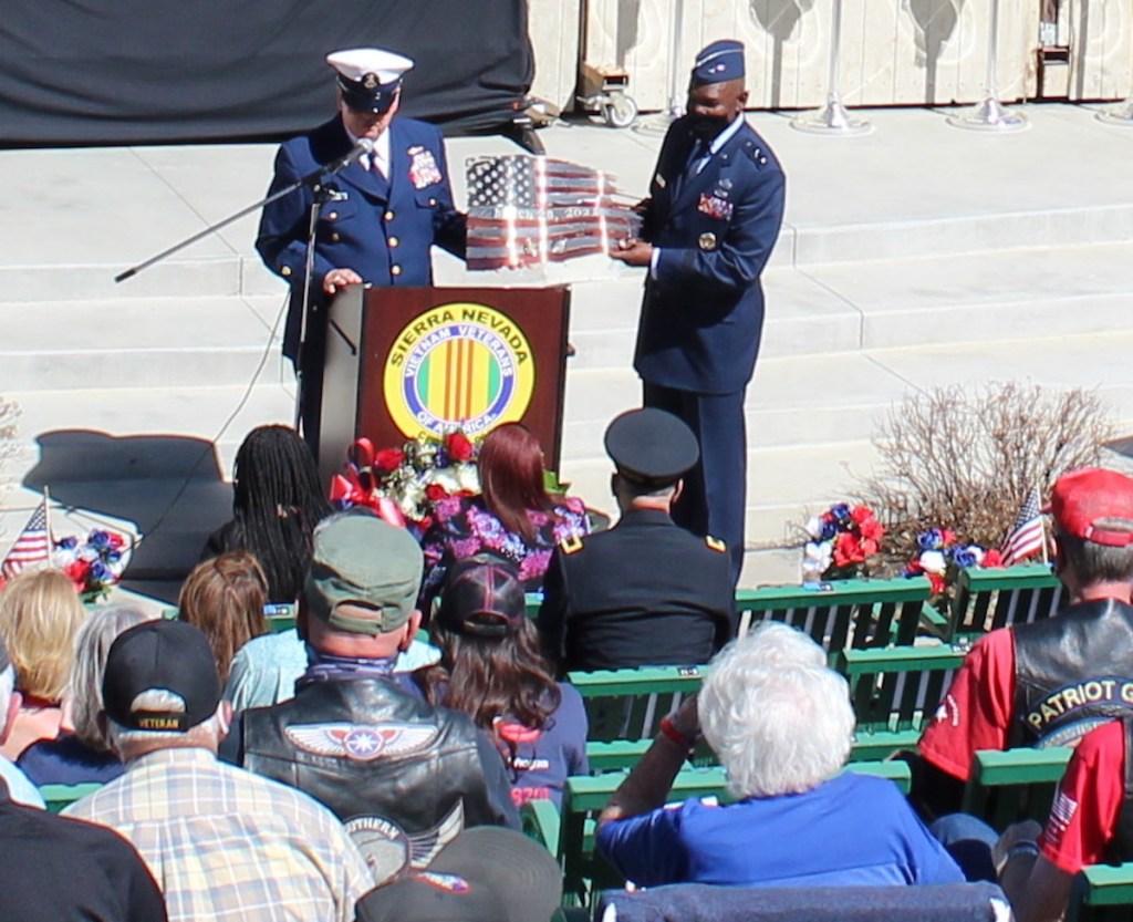 J.R. Stafford, left, president of the Vietnam Veterans of America, Sierra Nevada chapter 989, presents artwork to Maj. Gen. Ondra Berry, who spoke at this year's Vietnam Veterans Remembrance ceremony. Steve Ranson / LVN