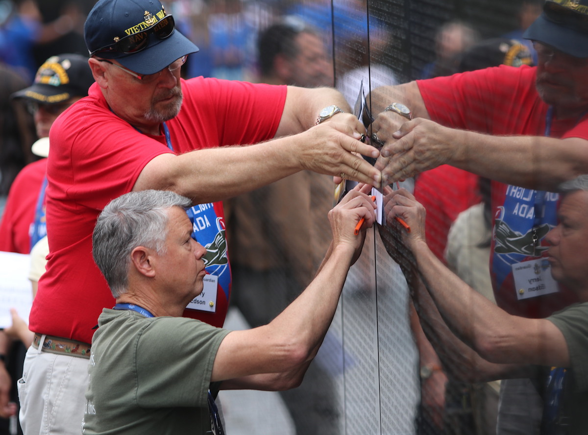 Jerry Edson, left, a Vietnam War veteran, and Jim Forbus find a specific name on the Vietnam Veterans Memorial Wall in Washington, D.C. during a June 2019 visit. National Vietnam War Veterans Day is Sunday, and a special program will be conducted at Bartley Ranch Regional Park in Reno and is hosted by the Vietnam Veterans of America, Sierra Nevada Chapter 989.