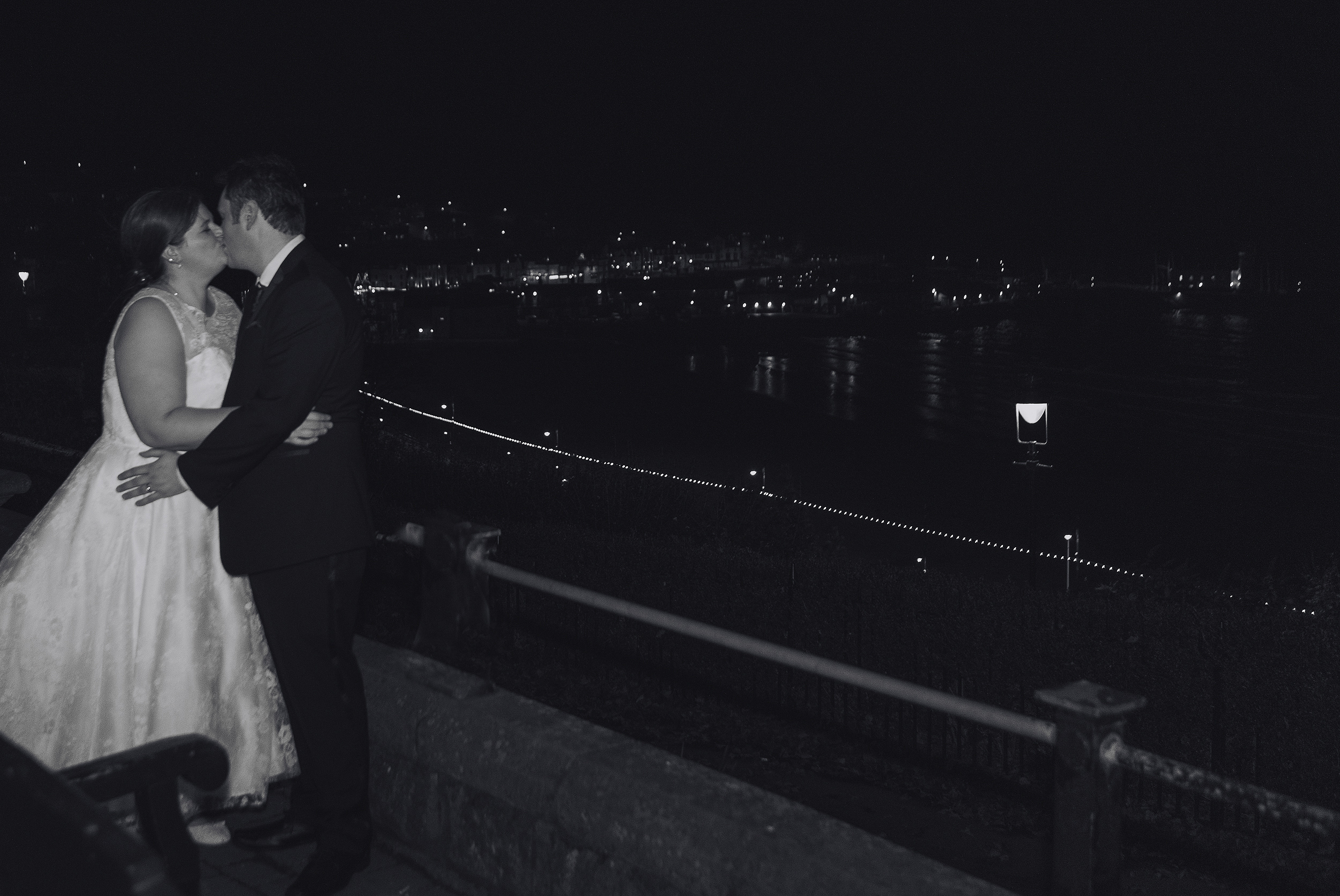 wedding photography bride groom kissing Scarborough bay black and white
