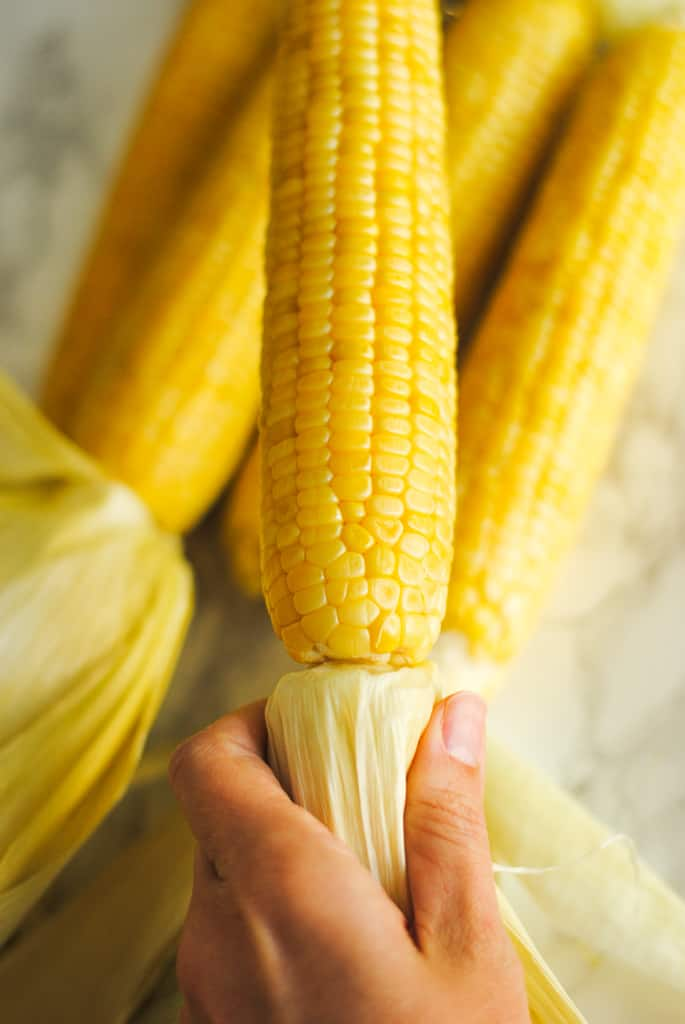 Oven roasted corn in hand