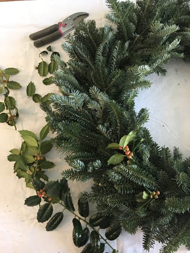 Winter wreath made with evergreen and holly
