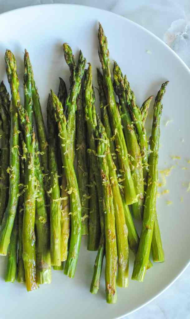 lemon roasted asparagus on white plate