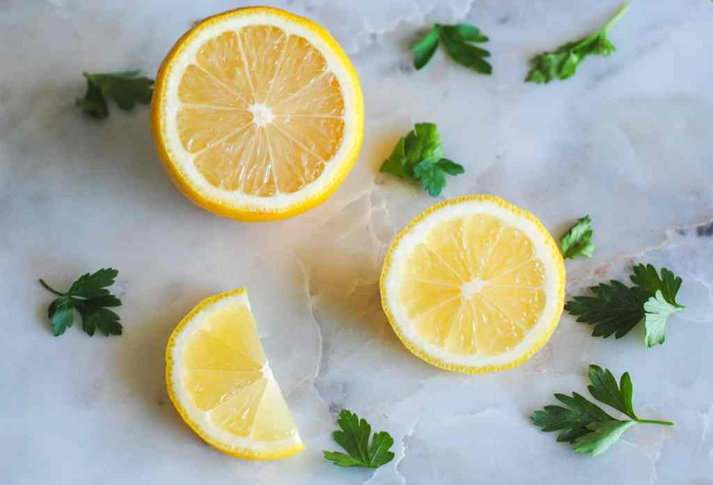 lemons and parsley on marble background
