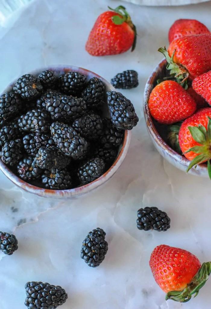 blackberries and strawberries in bowls