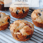 mixed berry muffins on cooling rack with text