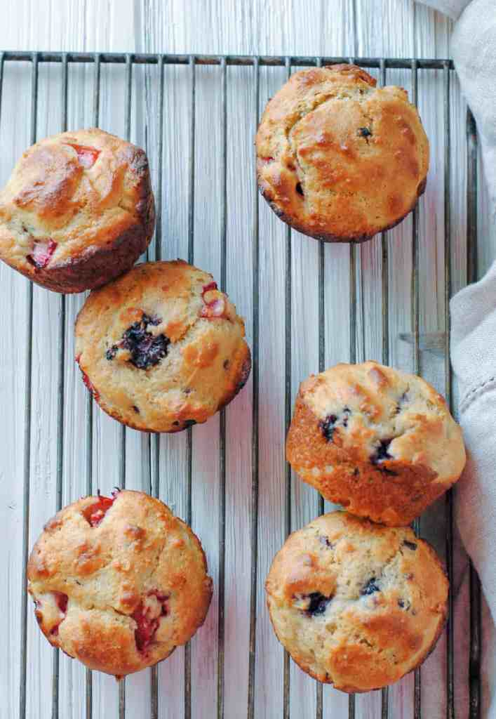 mixed berry muffins on cooling rack