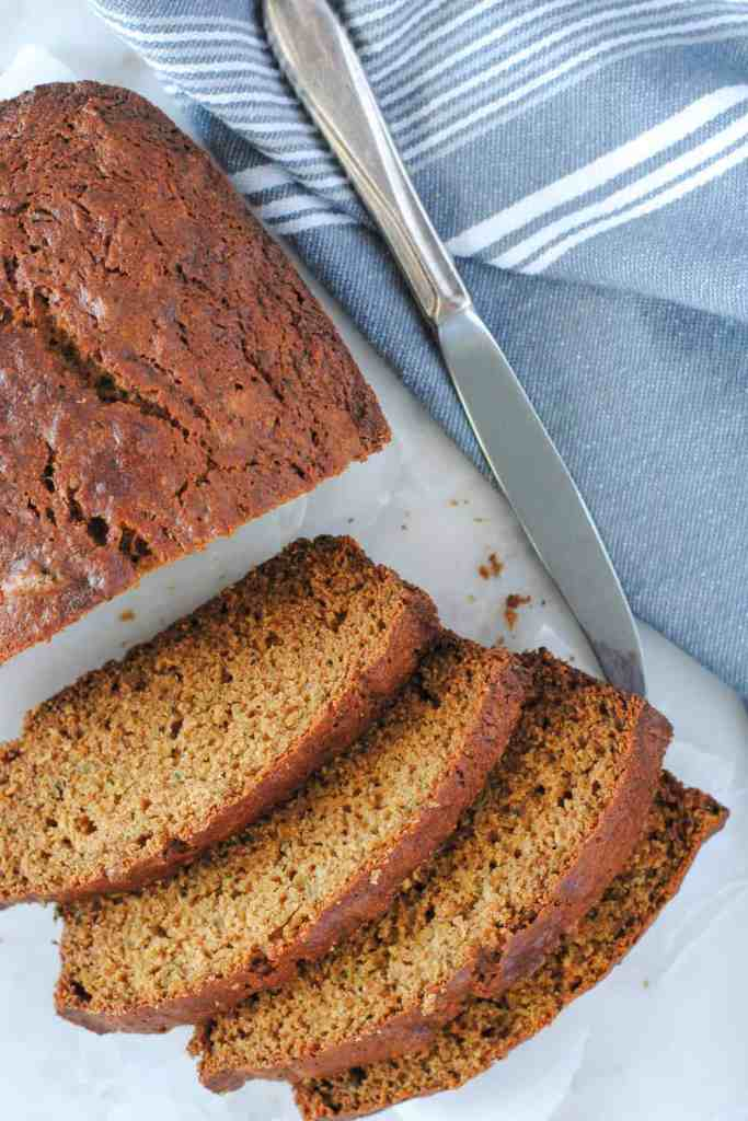 Healthy zucchini bread slices on marble background