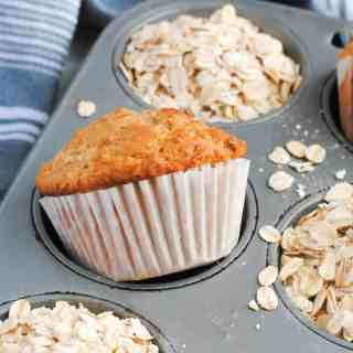 cinnamon oatmeal muffin and oats in muffin tin