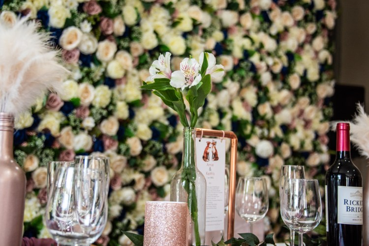 flower wall and copper centre piece wedding