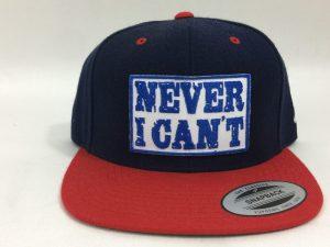 Gorra de moda Never I Can't roja y navy parche blanco letras azules