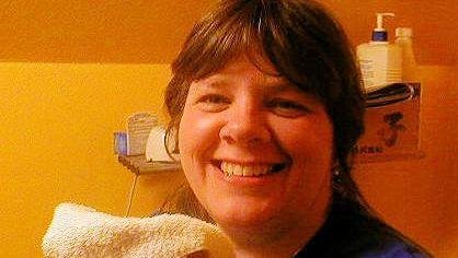 Teresa washing her face 2013