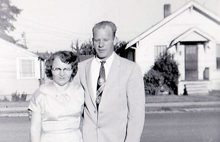 1950's couple standing in yard