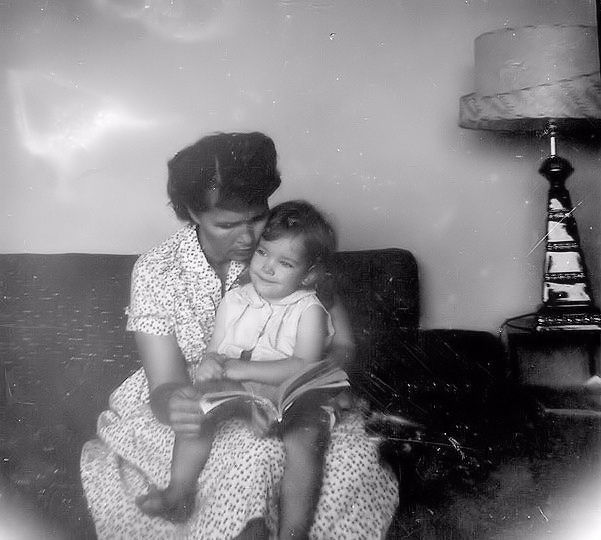 1960's mom reading to her daughter