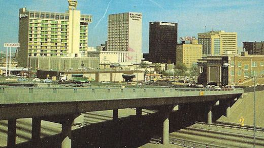 El Paso postcard featuring ONE yellow car on the whole freeway