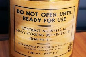 War surplus electrical relay in original can.
