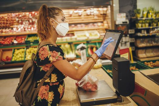 Woman using the self-checkout