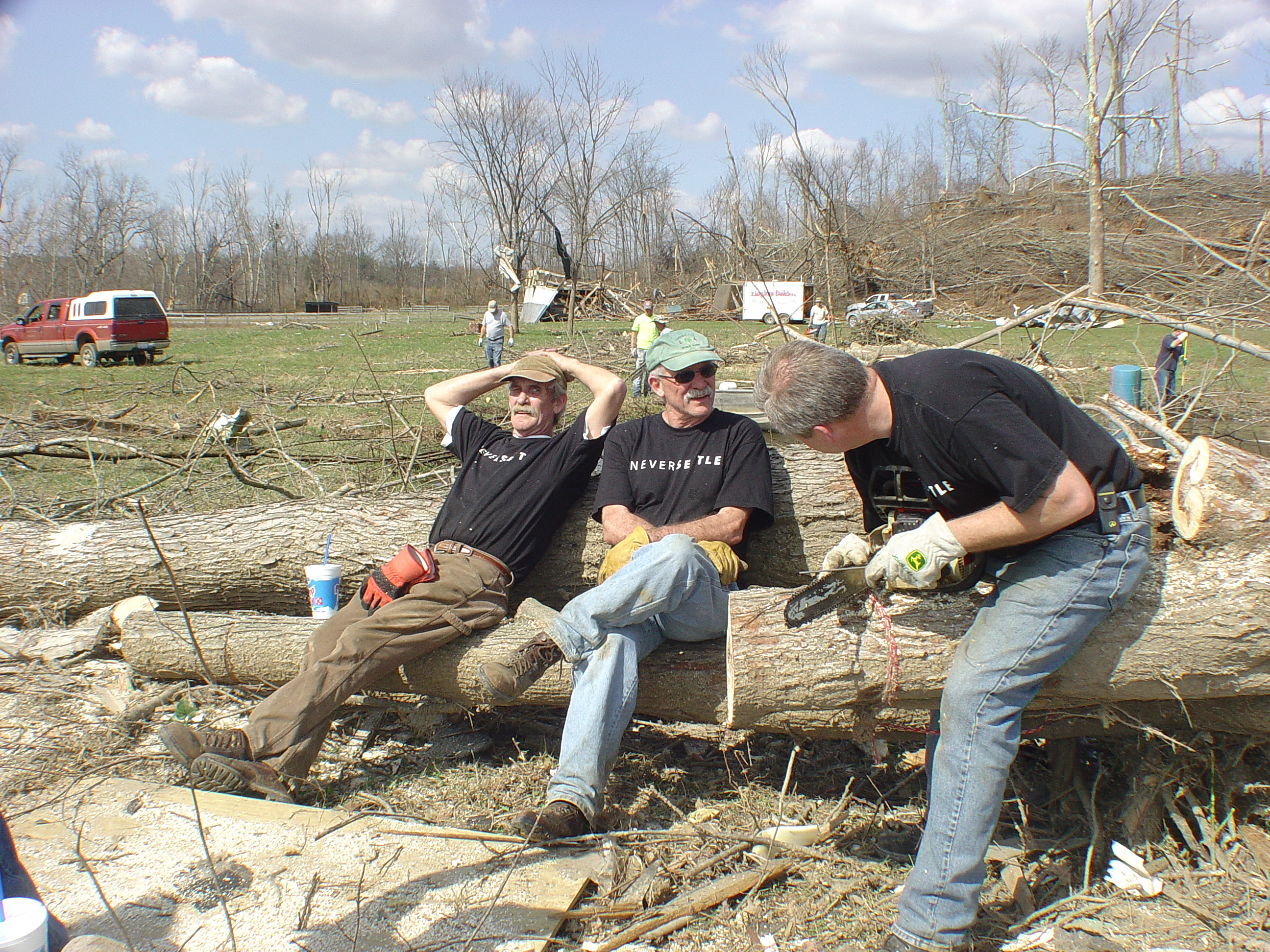 Never Settle volunteers take a quick break before continuing to clear debris.