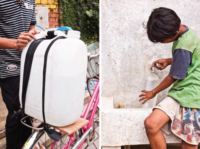 Community members fill up water jugs
