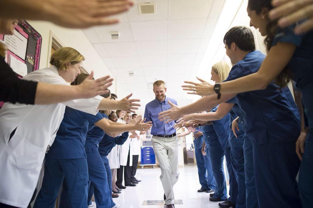 Dr. Kent Brantly gets high fives on the way out of Emory Hospital