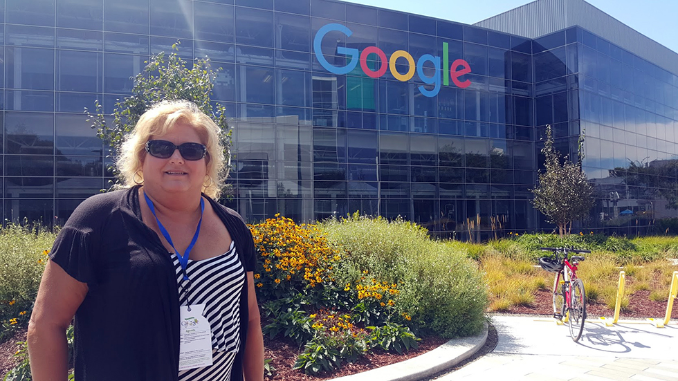 Mindy Pittman standing in front of Googleplex